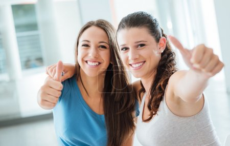 Photo for Cheerful teenager girls thumbs up smiling at camera, youth and enjoyment concept - Royalty Free Image