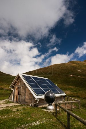 Photo for Solar panels on a mountain hut, electrical energy production and environmental conservation concept - Royalty Free Image