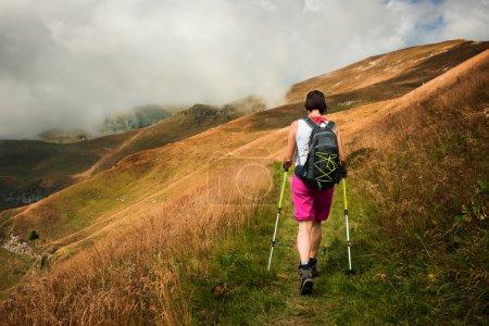 Woman hiking using hiking poles