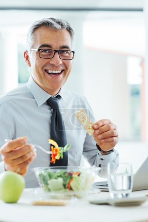 Smiling businessman having a lunch break