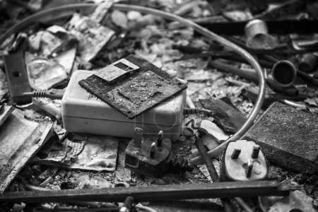 Charred remains of floppy disk and office equipment