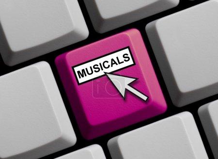 Photo pour Clavier d'ordinateur avec la flèche de la souris montrant des comédies musicales - image libre de droit
