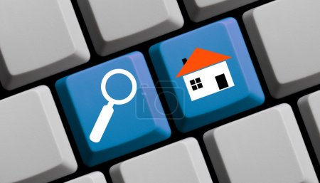 Photo for Search for real estate online - symbols on computer keyboard - Royalty Free Image