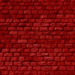 Brick wall with many stones and red color...