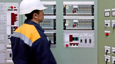 Engineer Presses Button Checking Gas Panel