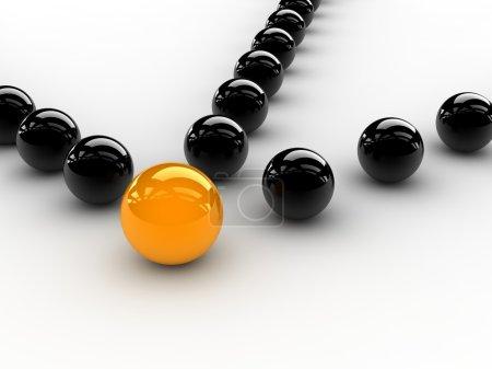 Photo pour Une sphère jaune placée observablement dans un groupe de sphères noires. . - image libre de droit