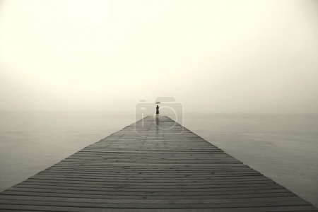 Photo for Woman with black umbrella looking infinity in a surreal place - Royalty Free Image
