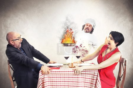 Photo for Incapacitated chef loose controll of the fire - Royalty Free Image