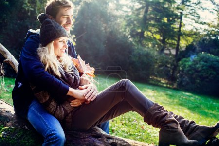 smiling couple with autumn background