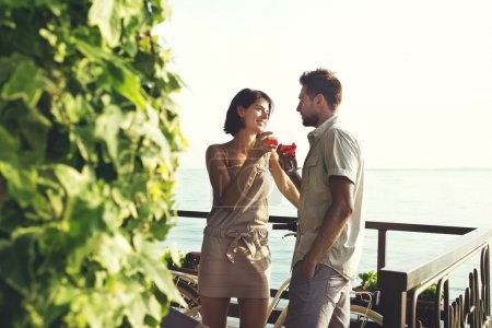 Photo for Couple in love having spritz time with lake view - Royalty Free Image