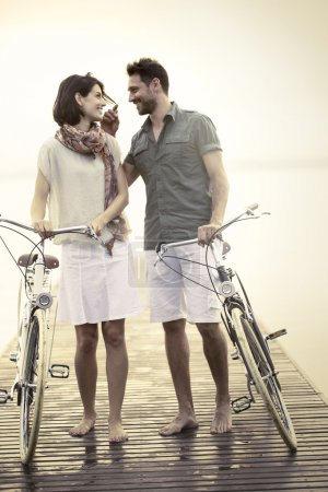 Photo for Couple in love pushing bicycle together - Royalty Free Image