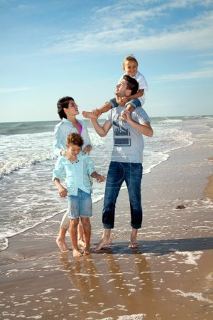 Photo for Happy Small Family Having a Vacation at the Beach During Summer - Royalty Free Image