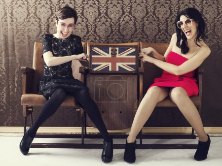 pin up girl quarreling for a cosmetic bag full of makeup in a tr