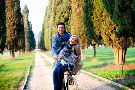 Photo for Couple having a bicycles race into the nature - Royalty Free Image