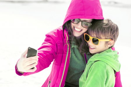 Mother and son making a selfie in montain