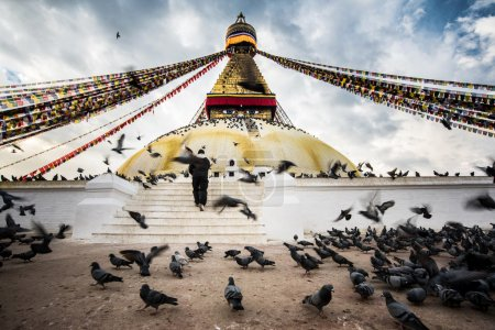 Bodhnath stupa with flying birds and people hope at Nepal