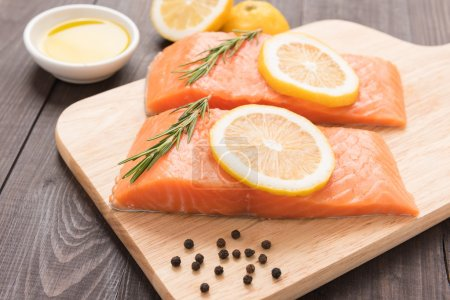 Fresh salmon and lemon on the wooden table