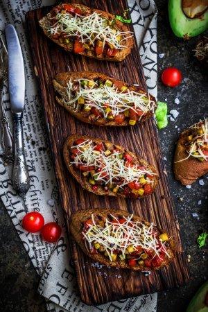 Bruschettas with tomatoe and avocado.