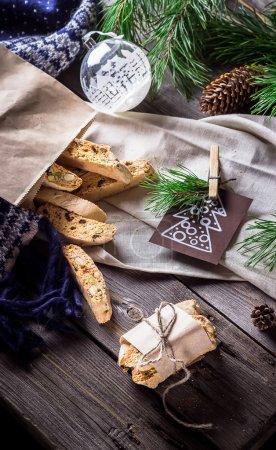 Italian bescotti cookies on wooden background.