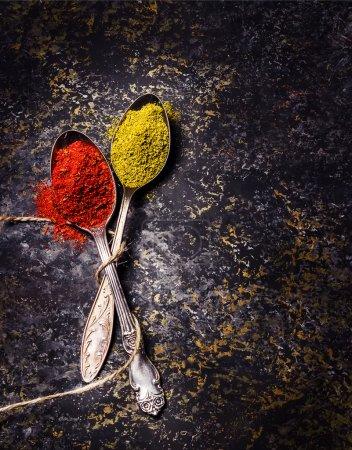 Spices on dark stone background.