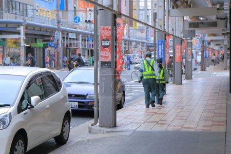 Parking ticket inspector Osaka Japan