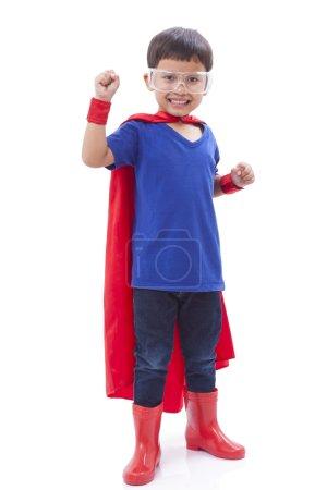 Little boy pretending to be a superhero