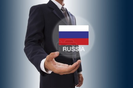Photo for Businessman hand showing Russia Flag - Royalty Free Image