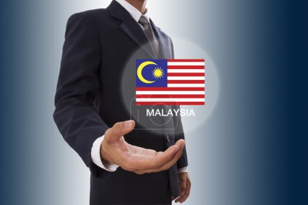 Businessman hand showing Malaysia Flag