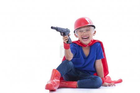 Child pretending to be a superhero with toy gun on white background