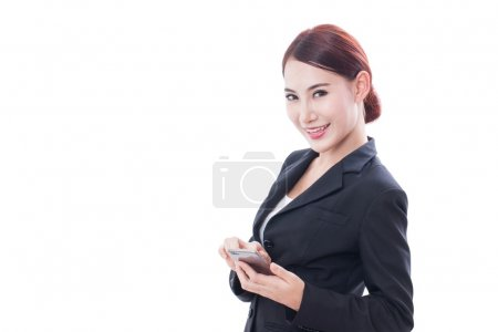 Portrait of young business woman using a mobile phone