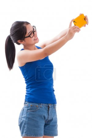 Photo for Young woman taking selfie picture in the studio - Royalty Free Image