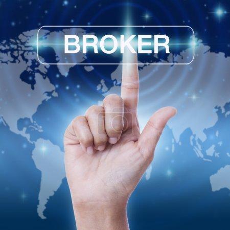 Hand pressing broker word button on virtual screen...
