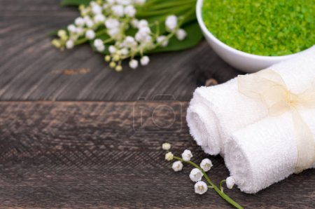 Natural green sea salt and towel for bath and spa ...