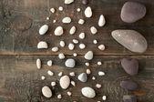 Sea stones on wooden background
