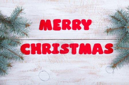 Christmas background. Handmade inscription Merry Christmas of fe