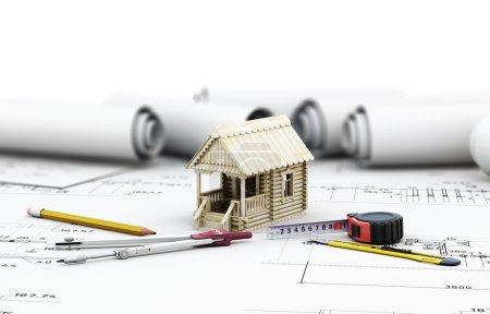 Werkzeuge des Architekten und das Holzhaus in den Zeichnungen
