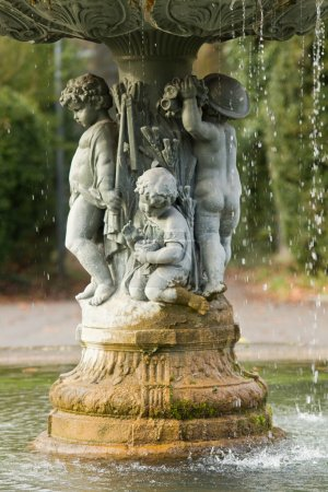 Ornamental fountain with figures of children in the park