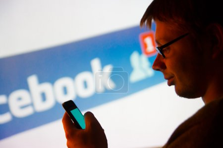 Man using Facebook application on smartphone