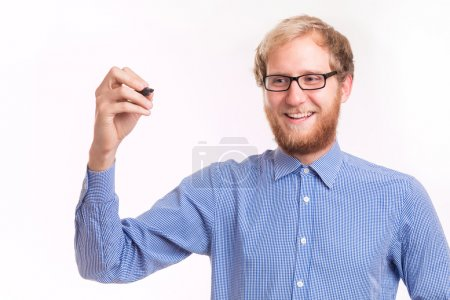 Young happy man writing on transparent board