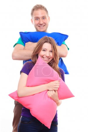 Man and woman holding  pillows
