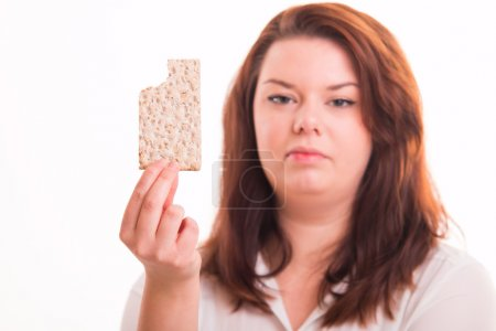 Low-calorie bread in womans hand
