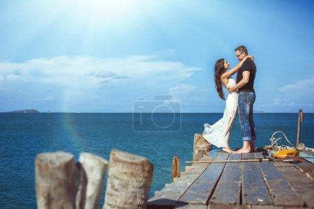 couple on the beach fishing