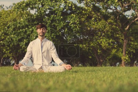 man meditating outdoor