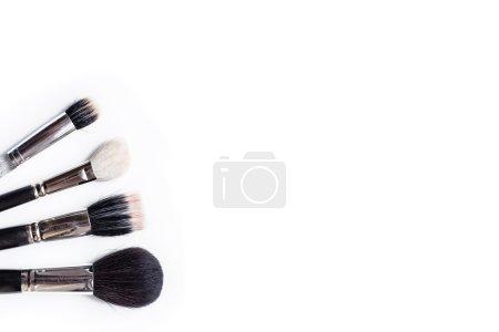 Photo pour Quatre pinceaux de maquillage - image libre de droit