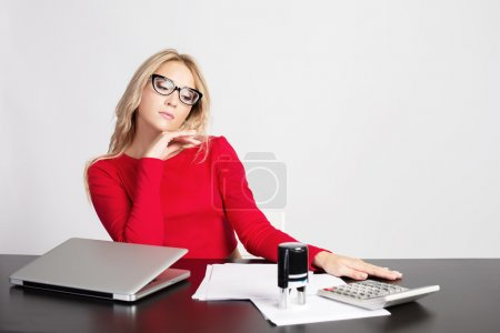 Young Business Woman at the desk with laptop