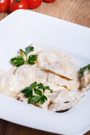 Dumplings with potatoes garnished with Sour Cream, Butter and Di