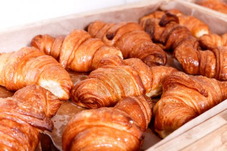 Sweet pastry, Croissants with chocolate and jam filling on shelf in Bakery shop. Pastries and bread in a bakery