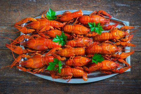Photo for Crawfish on wooden background in a plate - Royalty Free Image