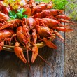 Crawfish on wooden background in a plate...