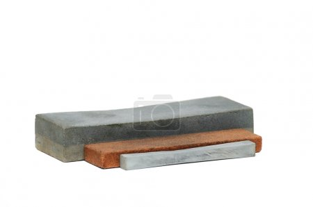 Stone for sharpening a knife isolated on white bac...